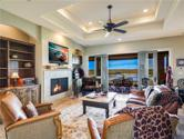601 Wesley Ridge DR, Spicewood, TX 78669 - Image 1: Lake Views from nearly every room! In this photo ... Double French Doors open to a Covered Terrace and the beauty of Lake Travis.  The Great Room boasts a Cozy Fireplace, sure to be enjoyed on chilly Texas evenings.