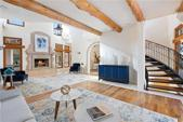 20217 THURMAN BEND RD, Spicewood, TX 78669 - Image 1: The formal living area with fragrant cedar beams and attention to detail at every turn.