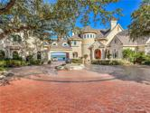 18109 Travis CIR, Lago Vista, TX 78645 - Image 1: French Provenal architecture, custom-designed and built on your own peninsula on the best part of Lake Travis