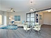 54 Rainey St #916, Austin, TX 78701 - Image 1: LIVING, DINING AND STUDY/GUEST BEDROOM. THE DOORS SLIDE CLOSED FOR PRIVACY.