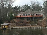 Lake Jordan - 359 Hickory Hill Road, Wetumpka, AL 36092 - Image 1: Here is the view of this great home from the lake. It has a nice sea wall and a boat house with a lift.
