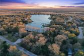10718 Lakefront Drive, College Station, TX 77845 - Image 1: 0.8 Acres situated at the corner of Lakefront Dr and a Cul-de-sac Inlet overlooking Brooke Lake.