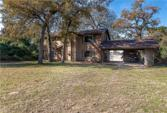 20 Post Oak, Hilltop Lakes, TX 77871 - Image 1: Love the trees!!  The property extends to the left into the woods.