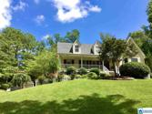 7721 CLAYTON RD, PINSON, AL 35126 - Image 1: This charming home is located in just the right place on this 1.37 acs overlooking the large front lawn with shady tress on each side of the driveway leading to the house. Park at the 2-car garage and walk around to the beautiful front porch and entrance
