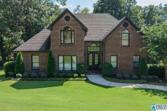 7035 SHADY OAKS LN, TRUSSVILLE, AL 35173 - Image 1: Welcome home! Curb appeal at it's best- custom iron double front doors, 3 zone sprinkler systems, updated landscaping, outside trim and siding repainted ~2016. Additional parking at pad near front door for guests.