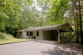 1030 Middle Connestee Trail, Brevard, NC 28712 - Image 1: One level living.  Screened porch is up in the trees.