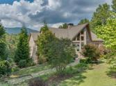 340 Highland View Lane Lot 4, Mill Spring, NC 28756 - Image 1: This mountain view home invites the outside in with natural light and natural setting.