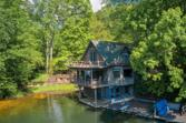 2000 W Lakeshore Drive, Landrum, SC 29356 - Image 1: Lake Lanier compound on the third basin includes a 3 bedroom home, two car garage, tons of parking spaces and even a boat garage and waterfront decks!