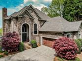 18017 Peninsula Club Drive, Cornelius, NC 28031 - Image 1: A beautiful home inside and out. Currently renovated to please most buyers. A stately brick and stone accented home located on Lake Norman. Long range lake views from all levels add to the beauty of this home.