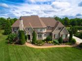 284 Milford Circle, Mooresville, NC 28117 - Image 1: French Country Estate in The Point at Trump National Golf Course - Lake Norman. Custom built (for builder's personal home), this property offers an exceptional floor plan with 5 bedrooms/4 bathrooms/3 half bathrooms plus a Media and Game Room with full bar.