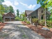 2198 Yellow Fork Trail, Nebo, NC 28761 - Image 1: Exclusive 3.4+ acre lakefront lot featuring cottage and garage with guest suite.