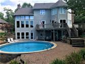 9856 Park Road, Effingham, IL 62401 - Image 1: Lakeside of home pool and decks