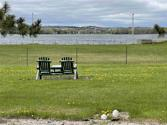 1674 BERKSHIRE DR, Gladwin, MI 48624 - Image 1: Unobstructed view of Lake Lancer and front row seats to July 4th fireworks