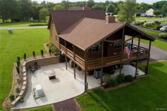 5813 Blue Ridge Rd, Mineral, VA 23117 - Image 1: Landscaped with retaining wall, open patio, covered patio, and covered wrap deck.