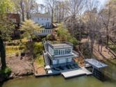 8364 LAKE Drive, Snellville, GA 30039 - Image 1: Welcome Home!  This is a very special lake front property - This view is of the Boat House and the back of the Main House