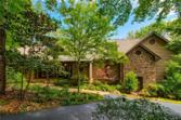 95 Swallow Point, Big Canoe, GA 30143 - Image 1: Distinctive mountain architecture featuring natural elements enhanced by lush professional landscaping and a coveted circular driveway.