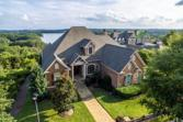 6806 S Bluff Court, Gainesville, GA 30506 - Image 1: Enjoy scenic unobstructed views of Lake Lanier in this one of a kind Lake Lanier home.  Sitting high on a bluff with views that will enrapture, come inside and you will be immediately WOWED!