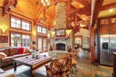 642 Shetland Trace, Big Canoe, GA 30143 - Image 1: This beautiful home has spectacular beams and a soaring Tennessee field stone fireplace in the great room.