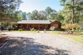 11909 Highway 212, Covington, GA 30014 - Image 1: Imagine coming home or getting away for a few days to your own private retreat. At the end of a private circular drive, an authentic Log Home.