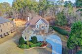 6709 WOODED COVE Court, Flowery Branch, GA 30542 - Image 1: Welcome Home to this Custom Home on .66 acres