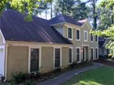 7211 Waters Edge Drive Lot 42, Stone Mountain, GA 30087 - Image 1: Freshly painted stucco with white trim.