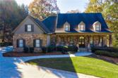 6713 Wooded Cove Court, Flowery Branch, GA 30542 - Image 1: This beautiful home is located in a cul-de-sac with a natural stone exterior design, oversized front porch, private views and lake front view from the back of the home.