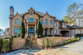 4576 OGLETHORPE Loop, Acworth, GA 30101 - Image 1: Welcome to one of the most elegant custom built homes you will see! Stunning architectural exterior details & magnificent stone work.  Note the porte-cochere to the right & large motor court!
