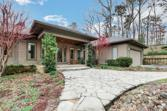 33 EAGLE Drive SE, White, GA 30184 - Image 1: The property has a beautifully landscaped front entrance with countless flowering foliage.