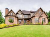 501 Gold Shore Lane, Canton, GA 30114 - Image 1: Quality craftsmanship with extensive woodwork, this 4-sided brick & stone home is an oasis from everyday life.
