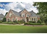 2025 Gold Leaf Parkway Lot 3572, Canton, GA 30114 - Image 1: Four-sided brick custom built home with 3-car side entry garage placed on .72 acre lot backing to Corps property with path to Lake Allatoona.