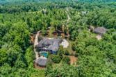 14 ESTATES Ridge, Acworth, GA 30102 - Image 1: Welcome to Palm Oasis Estate! This magnificent gated property has 10 private acres on a cul-de-sac & is walking distance to Atlanta Yacht Club at Lake Allatoona!