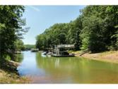 3329 Duckett Mill Road Lot 25, Gainesville, GA 30506 - Image 1: 1.75 acre lanier lot with single slip dock permit (no dock in place) only fishing platform. Has beach and property line in the water. No HOA