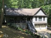 161 Tamarack Dr, Jasper, GA 30143-7516 - Image 1: An attractive home located just across from the golf course. This home has a lovely deep front porch from which to watch the golfers try their luck across the street. This driveway is as level as the get in the mountains!