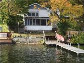5223 County Road 36, Richmond, NY 14471 - Image 1: Here is your new lakeside home as you will see it as you pull your boat into the aluminum dock. Nice and close to the lake for a quick swim.