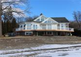 5524 East Lake Road, Conesus, NY 14435 - Image 1: View of the house from the lake.  Note the shale beach and decorative brick breakwall.