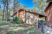 21 W Lakeside, Huntsville, TX 77320 - Image 1: Welcome home to your personal retreat.  Peaceful, wooded and near the water.  Home has NEVER flooded and is one of the few brick homes in the area.