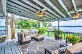 178 Sawmill Street, Crockett, TX 75835 - Image 1: This large covered veranda is ideal for entertaining friends and family.  The views from the deck never get old, you can sit for hours, relax and enjoy the beauty.