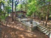 254 Fern, Livingston, TX 77351 - Image 1: How would you like to kick back and soak up the sunshine on this treasure. 2 leveled deck with seating areas on both levels and stairs to the lake.