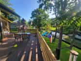 """148 Sandpiper Drive, Livingston, TX 77351 - Image 1: Gorgeous Views to enjoy your coffee on the 30' x 24"""" waterfront porch."""