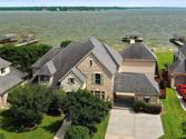 13714 Elm Shores Drive, Houston, TX 77044 - Image 1: Come live the lake life on this oversized lot with your boat and jet ski docks!