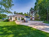 10252 Cude Cemetery Road, Willis, TX 77318 - Image 1: Front of spacious Mediterranean home with circle drive around circular fountain.