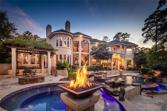 32 Tahoe Shores Court, Kingwood, TX 77346 - Image 1: The beauty of this spectacular spa-like setting is enhanced by the glow of five gas fire pots that surround the magnificent lighted pool.