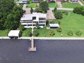 210 Lakeway Drive, Coldspring, TX 77331 - Image 1: An oasis built for entertaining , just north of Houston. Conveniently located, 3 story contemporary home with state of the art amenities throughout.  Lush, private setting, Boating, swimming, fishing, swim spa, this home has it all for you !