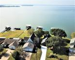 118 Buffalo Ct, Livingston, TX 77351 - Image 1: Welcome to 118 Buffalo Ct on Lake Livingston with outrageous open water views of Pine Island