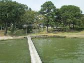 11500 190 Highway, Point Blank, TX 77364 - Image 1: VIEW OF PROPERTY FROM BOATHOUSE