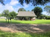 241 Bluff Drive, Livingston, TX 77351 - Image 1: Lake cottage on 2 acres with limited views of Lake Livingston.