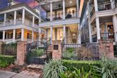 7 Southern Coast Drive, The Woodlands, TX 77380 - Image 1: Picture of the front of the home at sunset.