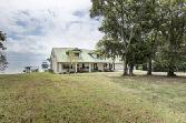 140 Old Post, Livingston, TX 77351 - Image 1: Beautiful waterfront acreage. This concrete block and stucco home with metal roof was built to last with low maintenance, and sits on over 2 acres. Per Seller.
