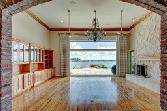 11346 Harbor Breeze Drive, Montgomery, TX 77356 - Image 1: What a fabulous great/family room with a stunning wall of a stone fireplace, rich wooden built-ins and hard wood floors, tall ceilings and Chicago Brick trim naturally frames the most lavish picture of the open water views.
