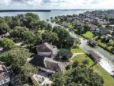 7818 Magnolia Cove Court, Humble, TX 77346 - Image 1: Aerial View of the home with Lake Houston and canal frontage
